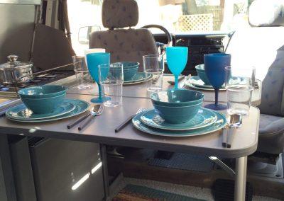 Dinner table inside a campervan