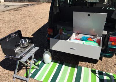 Camping gear outside of VW camper van