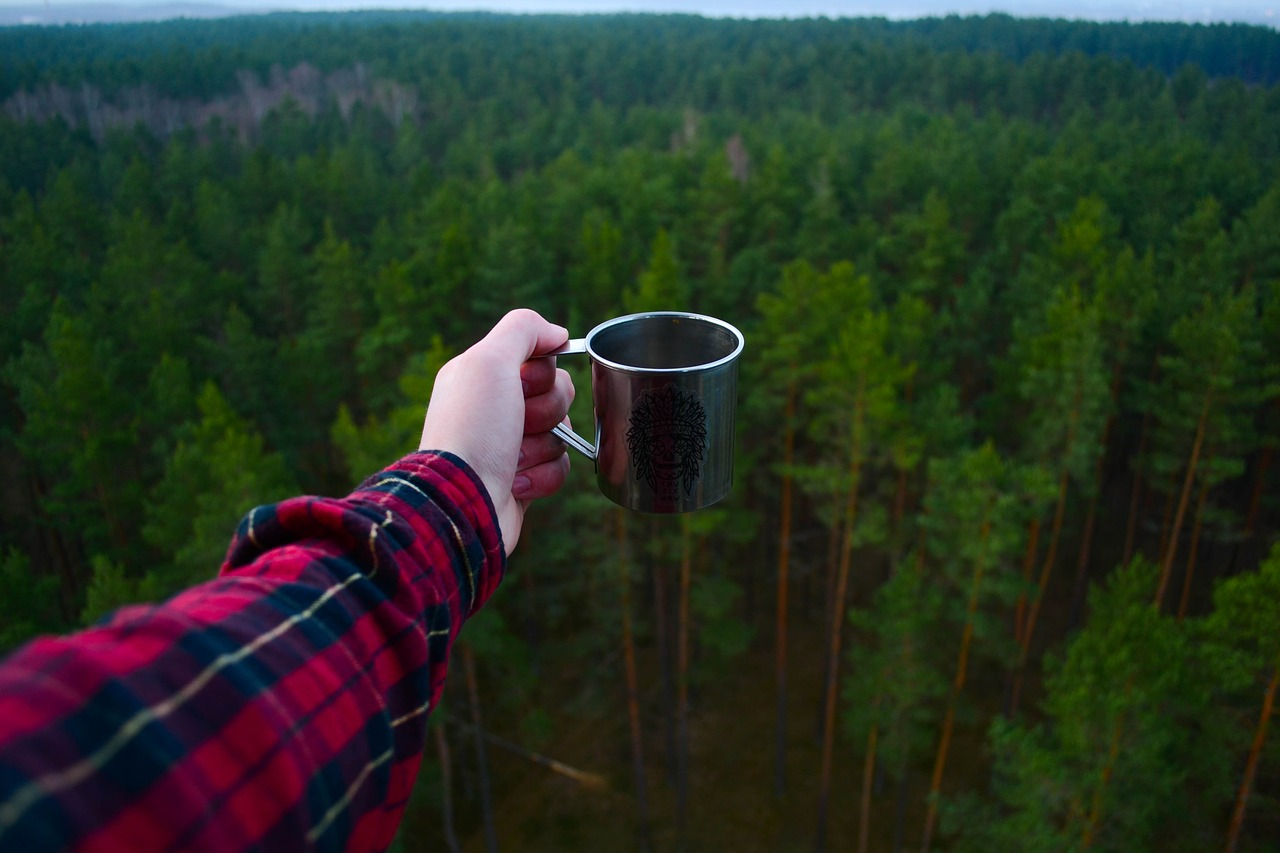 Camper holding coffee